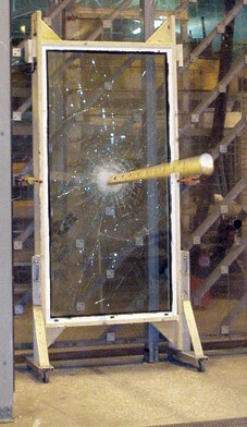 Image of lumber hitting hurricane windows